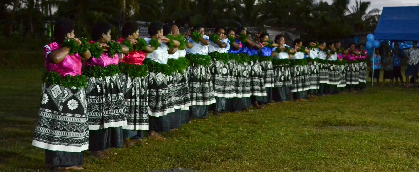 Local women in Fiji perform a ceremony for the opening of a Community Centre at a placement lead by Projects Abroad Staff.